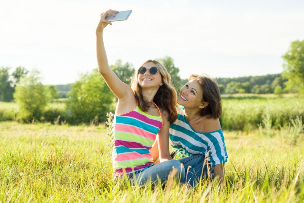 image of mother and daughter taking a selfie